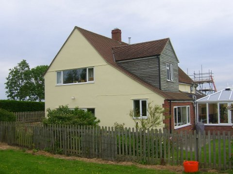 Side and rear view of house after painting