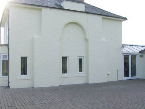 the rear of the wall with an external wall coating applied - Exterior Coatings For Houses