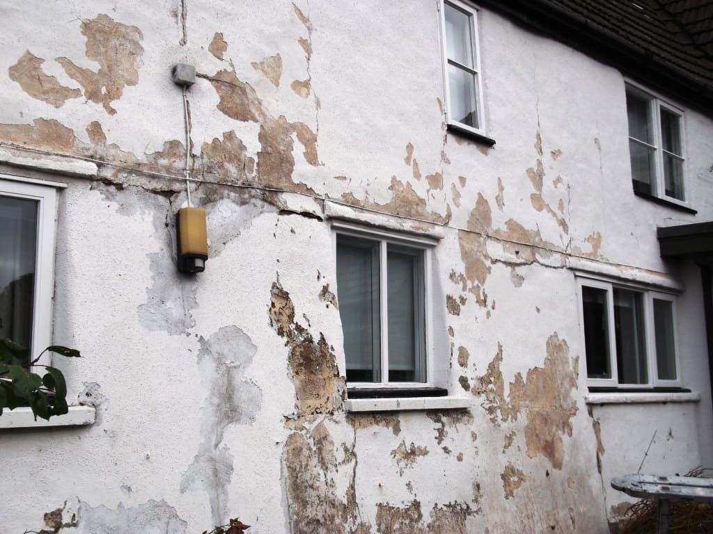flaky paint due to penetrating damp