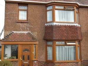 front of Brighton Cracked pebbledash house before painting