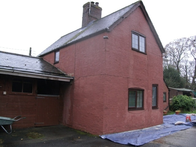 A painted brick house in Farnborough, Hampshire in need of brightening up