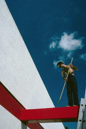 Man painting iron beam