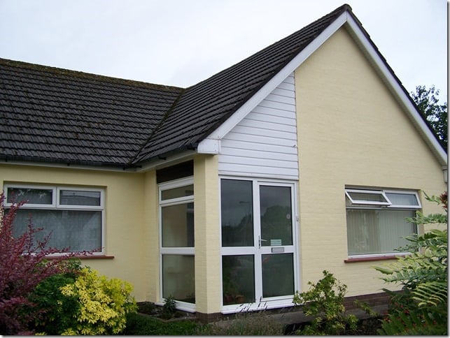 A bungalow after exterior wall coatings