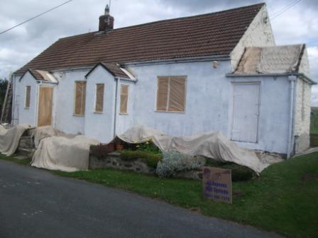 extended-rural-bungalow-with-a-wall-coating-paint-front-primer