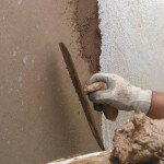 Applying plaster to a wall with a trowel needs a good wrist action and confidence
