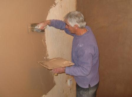 Plastering an internal wall.