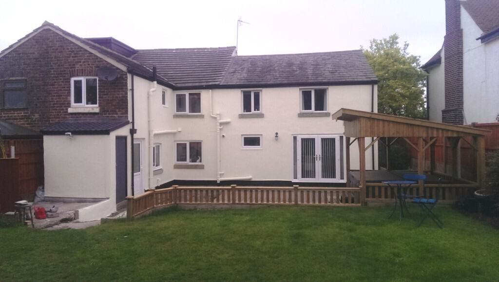 A house in warrington Cheshire with an exterior wall coating