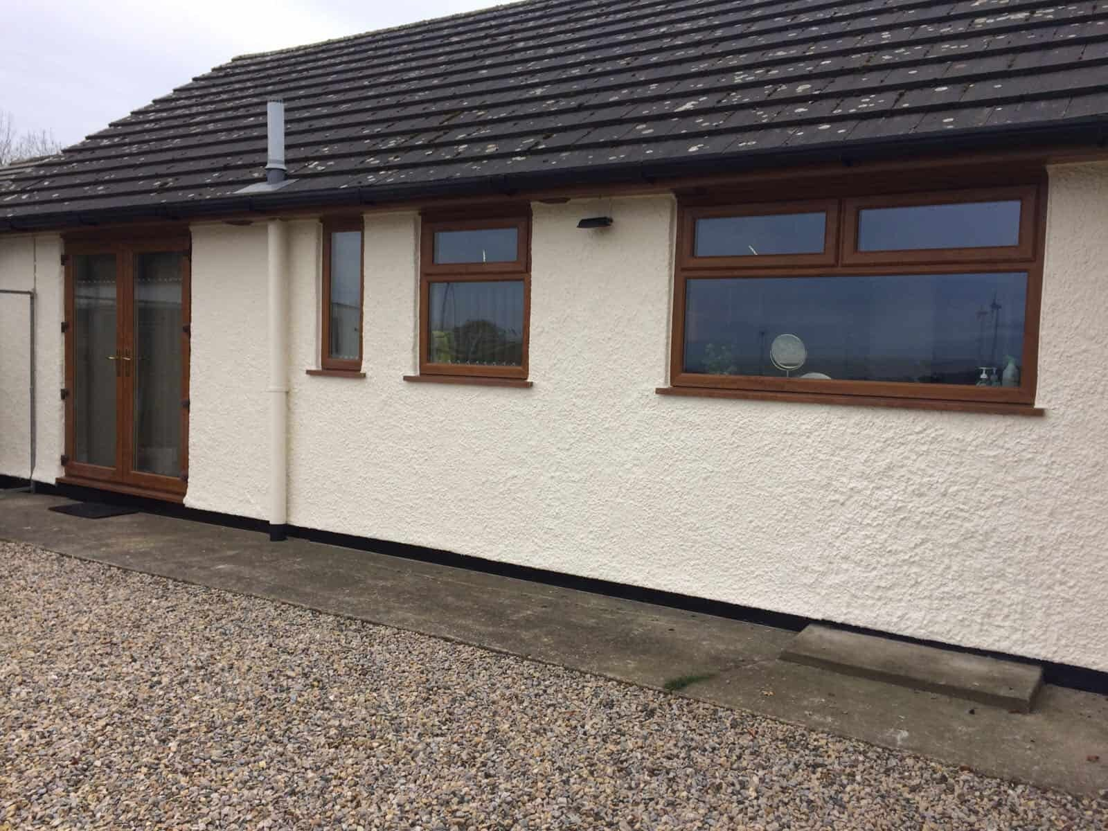 A bungalow having been painted externally in cumbria with wethertex textured wall coating