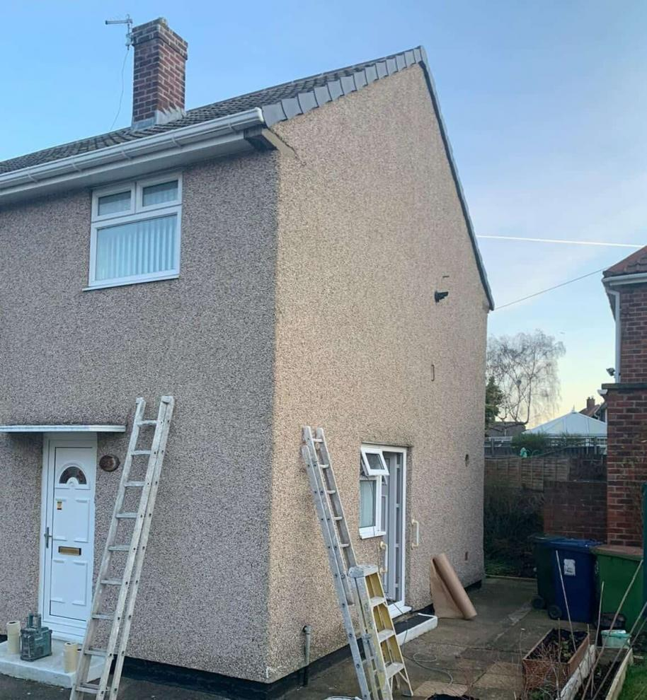 A pebbledashed house in Middlesbrough about to be painted with an exterior wall coating