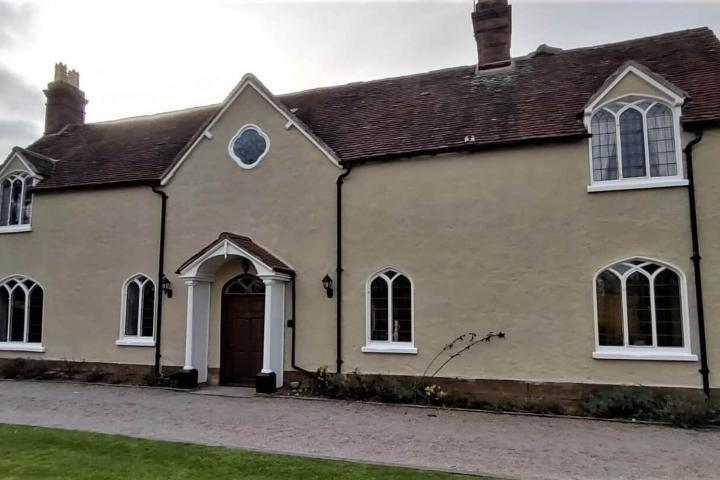 AFTER front of grade 2 listed farmhouse with Wethertex exterior wall coating applied