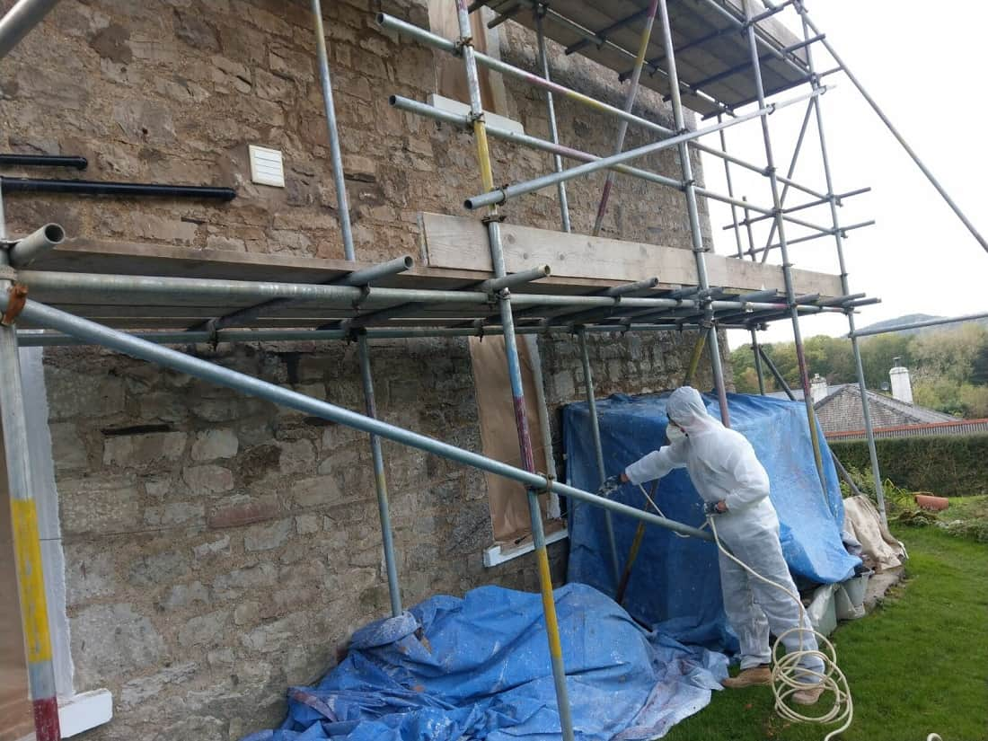 Applying NPA Wetherdry clear damp proof wall coating