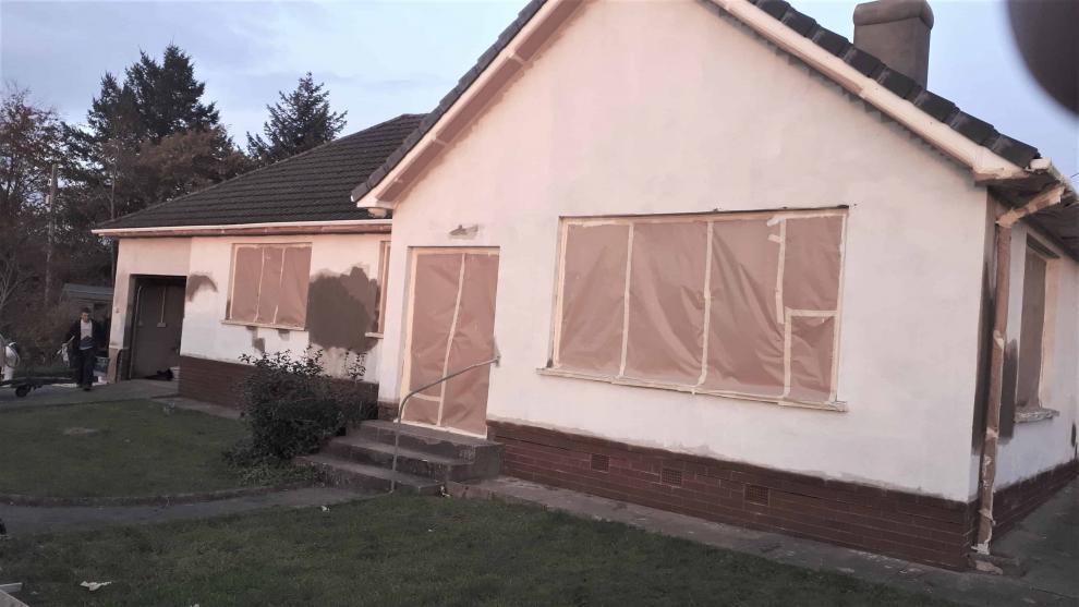 Devon bungalow with primer on walls ready to spray wethertex masonry wall coating
