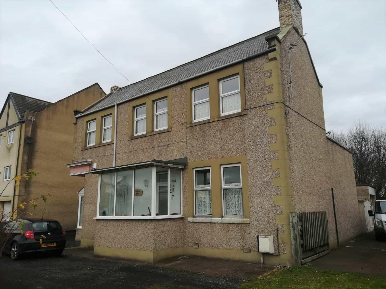 Front of pebbledashed house before masonry coatings-min