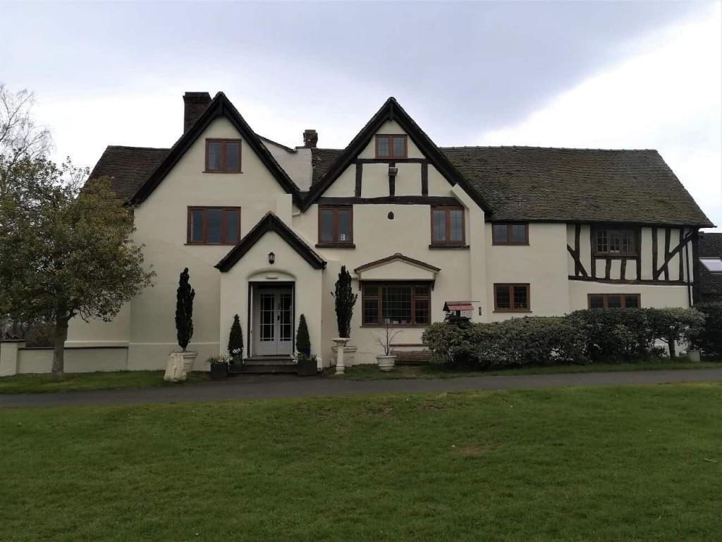 Full shot of front elevation of grade 2 listed house before painting-min