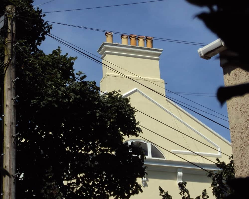 Gable end wall of a victorian villa showing large chimney stack