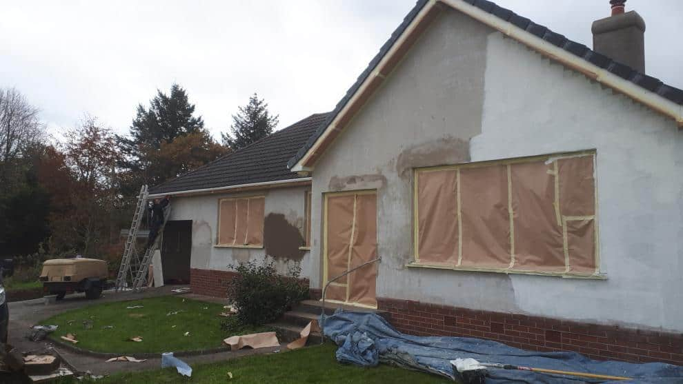 Patch repairs to rendering and application of primer coat before applying wall coating paint