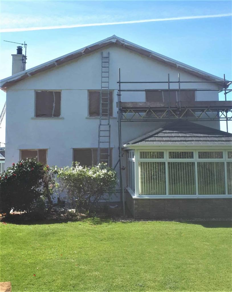 This shows the rear of a house in Truro Cornwall being repaired and painted by our team