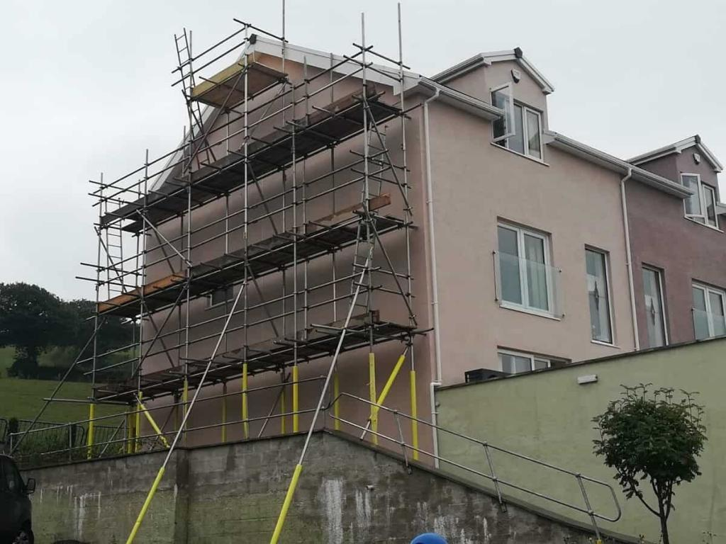 Scaffolding on pine end of house in Colwyn bay