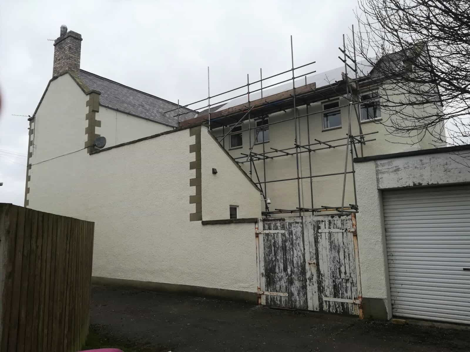 Side and rear of house after masonry coatings-min