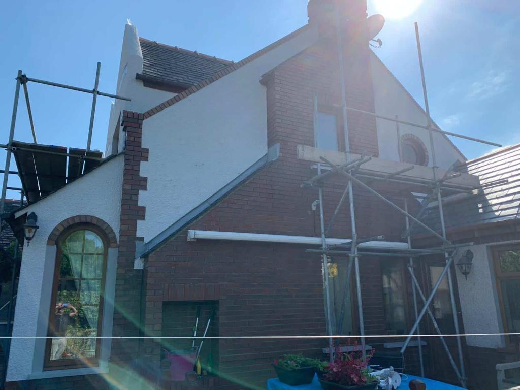 Side of house in barrow in furness after exterior wall coating, showing the scaffolding being put up