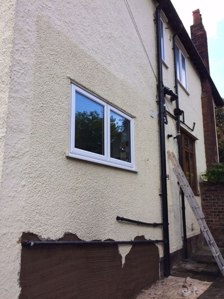 Side of house in wirral having render repair