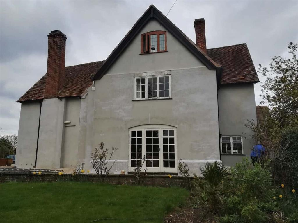 Side of house showing bare render-min