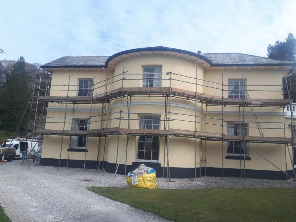 Side of manor house with new paint from wethertex wall coatings