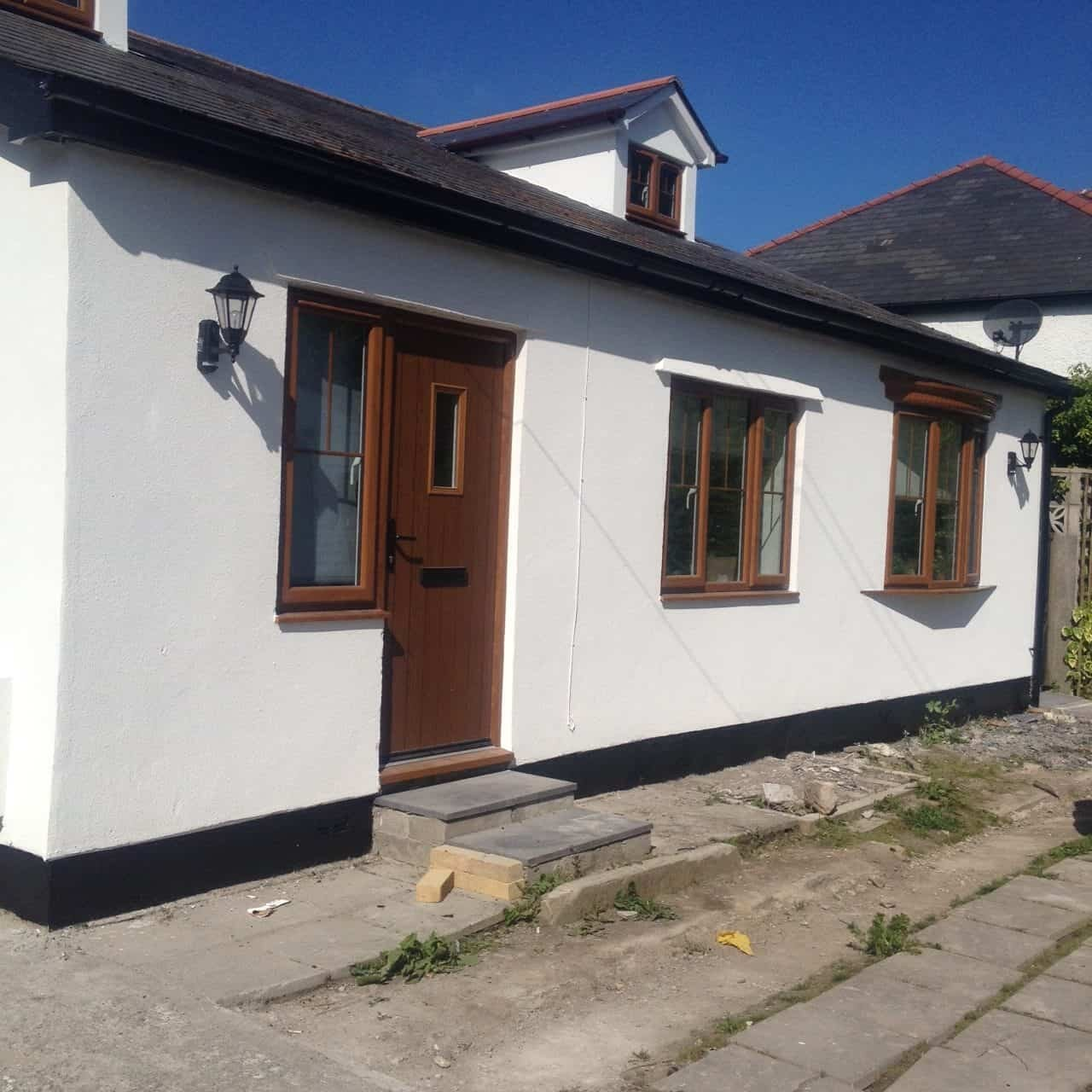 Smooth render and new paint for a house in wales