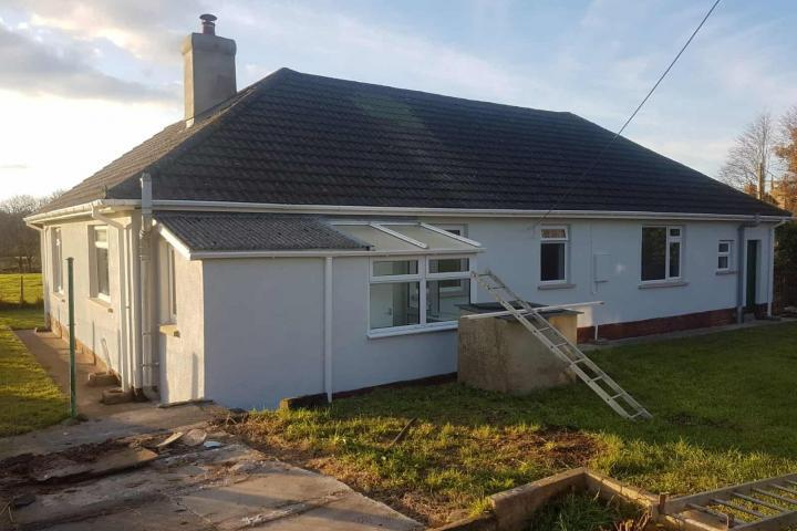 Textured exterior wall coating on rear and side of rural bungalow in Winkleigh Devon