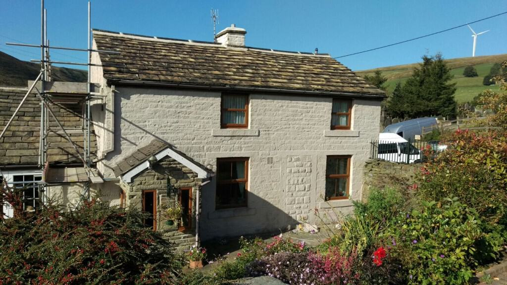 Working on stone cottage in the pennines