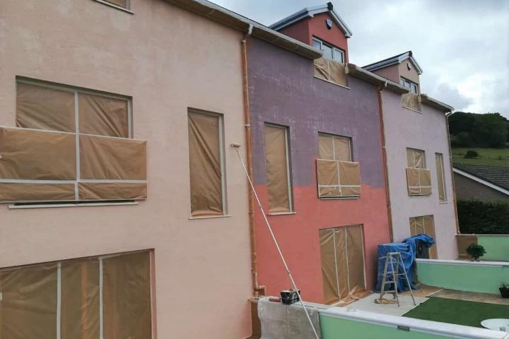 applying primer to house in north wales-min