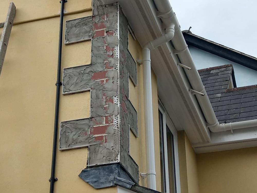 ongoing repair work to corner exterior wall