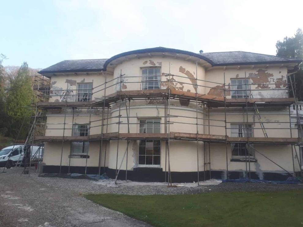 flaking paint on manor house