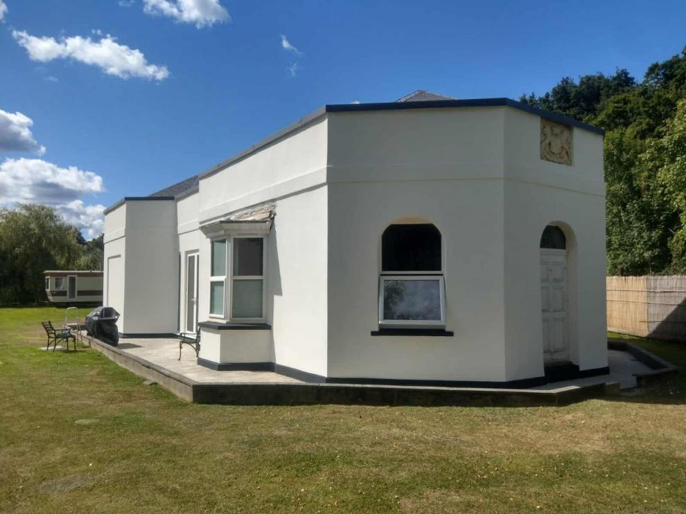 front of ghrade 2 listed house with never paint again wall coating