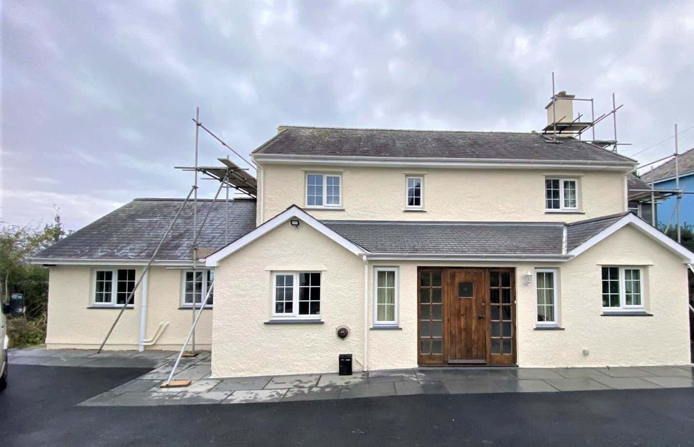 front of house in criccieth wales with a wall coating now installed