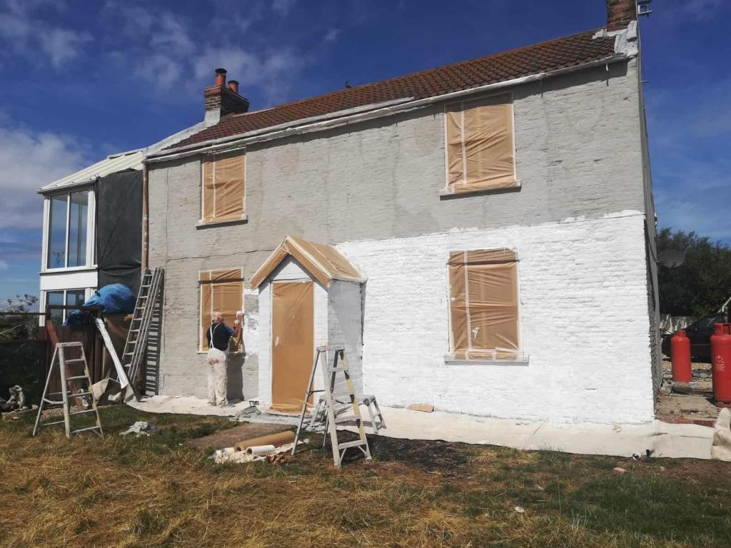 ront of house in hull with masking and primer-min