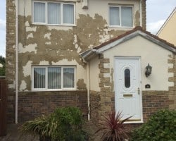 front of house with terrible flaky paint