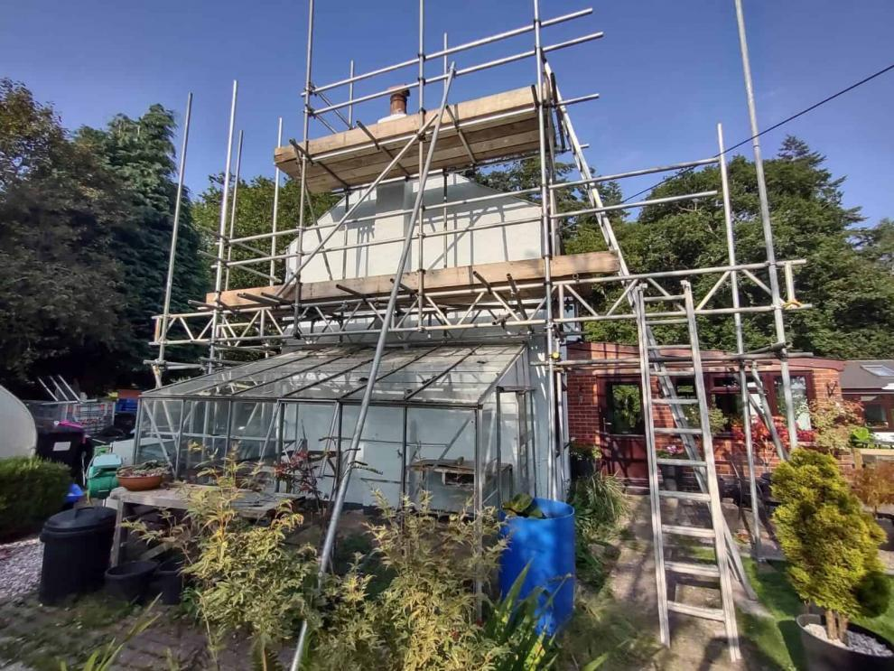 gable end of house with scaffolding