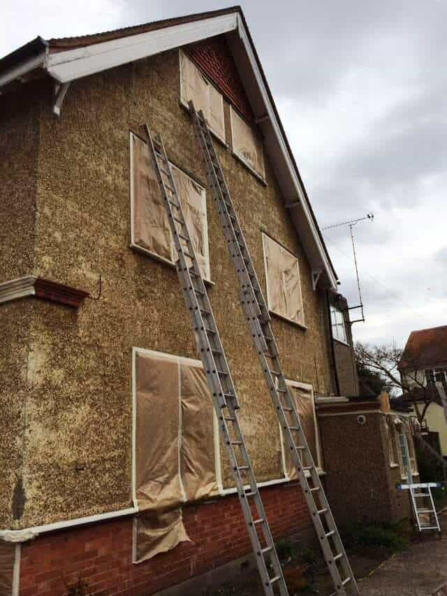 pebbledashed home in Farnborough, Hampshire getting windows masking up before work starts
