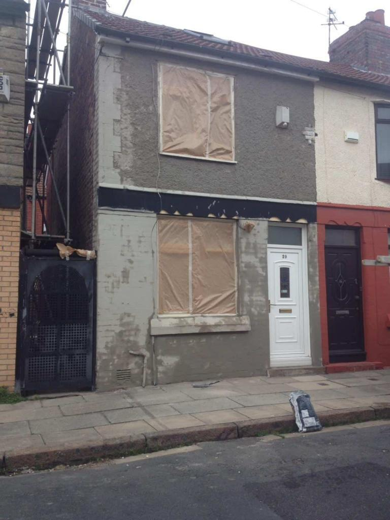 house in liverpool, masked up and with bagging coat-