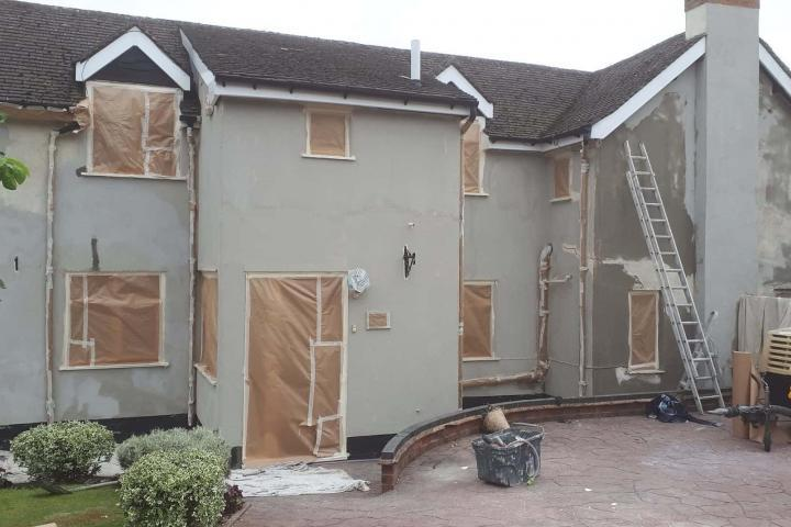 house rendered at rear next stage is priming