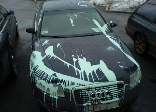 paint splatted on a car