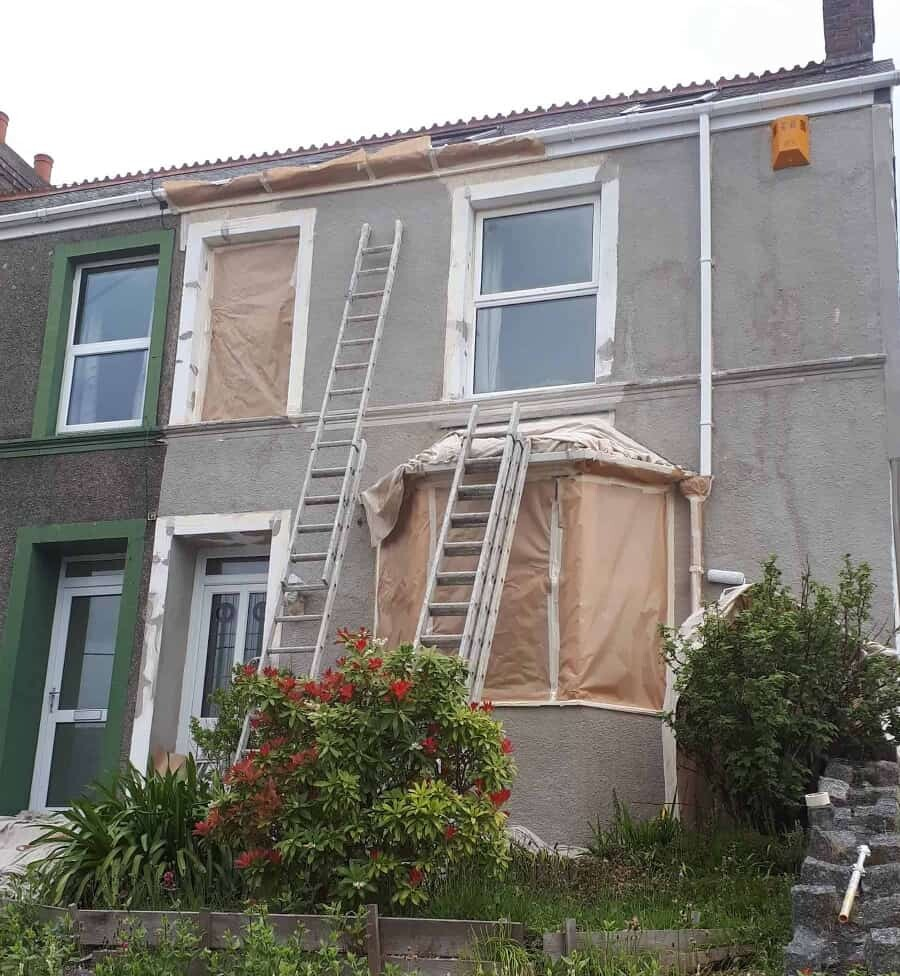 pebble dashed house prepared for painting