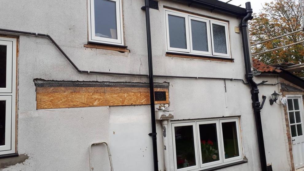 poor rendering and lintel over old doorway