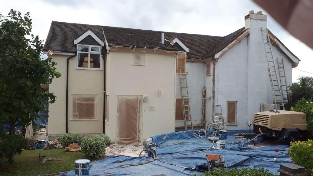 rear of house in redditch during wall coating spraying work