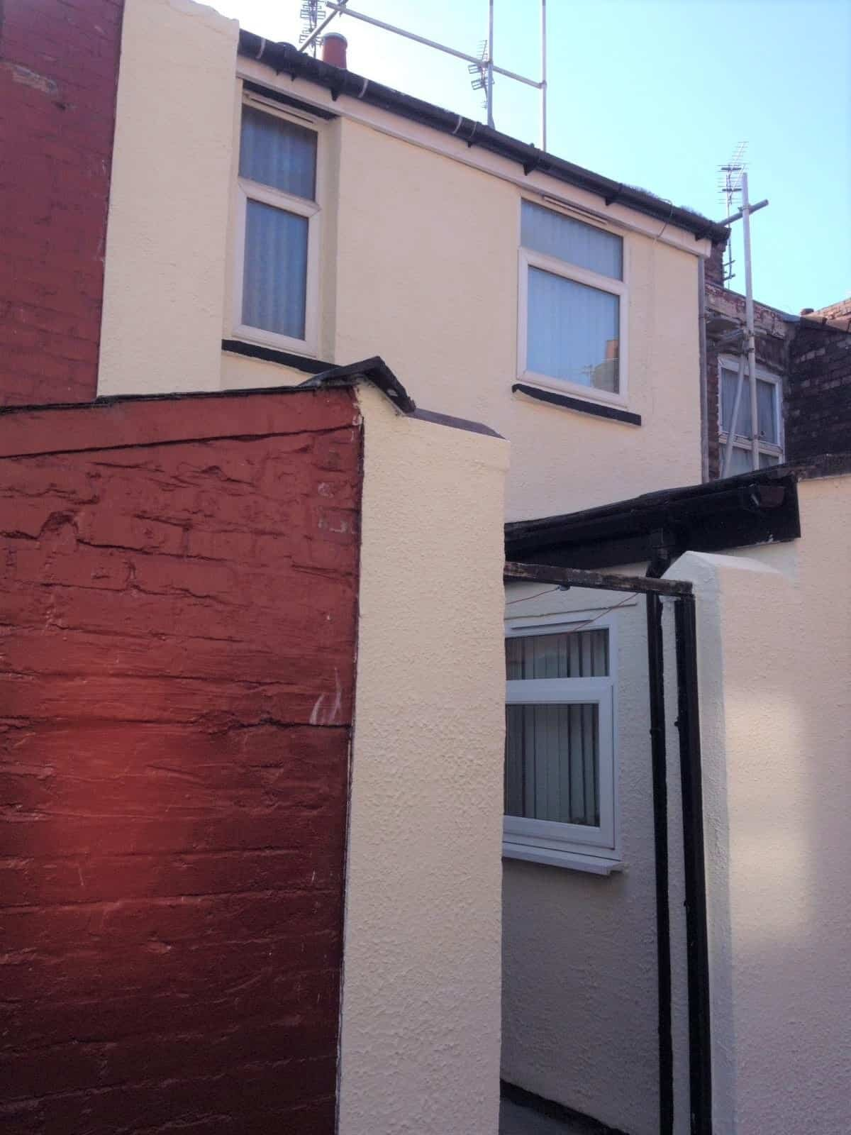 rear of terraced house in liverpool with a new paint job-min