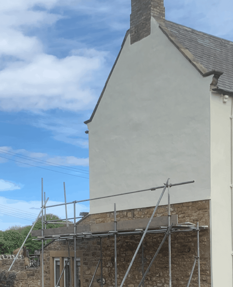 render fixed and protected with a never paint again exterior wall coating