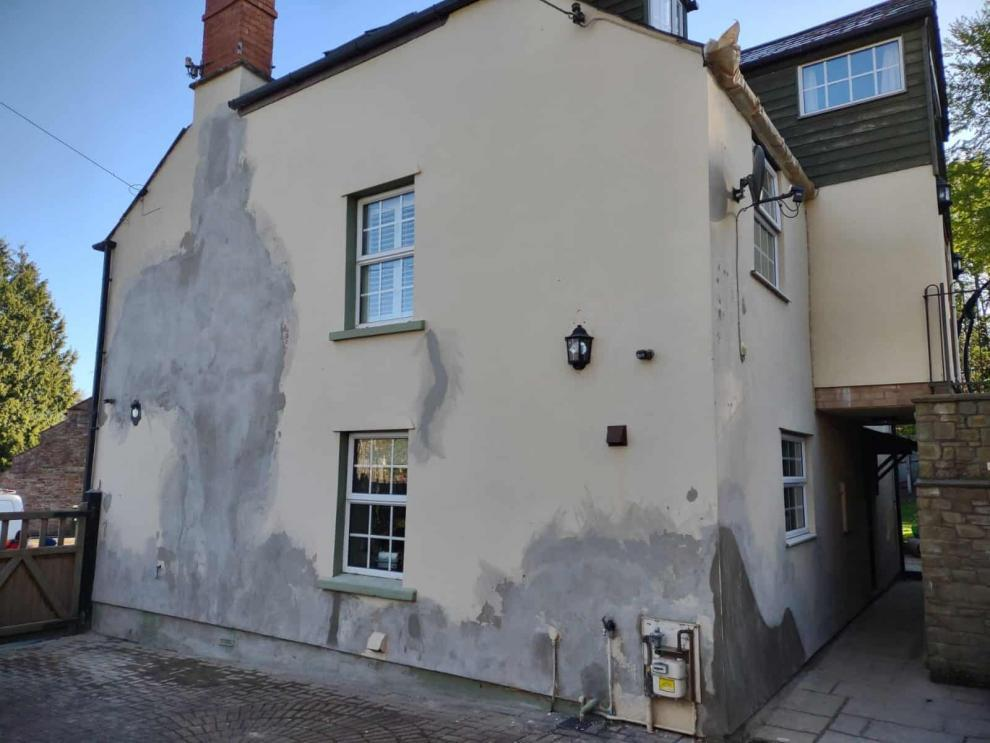 repaired render on side wall