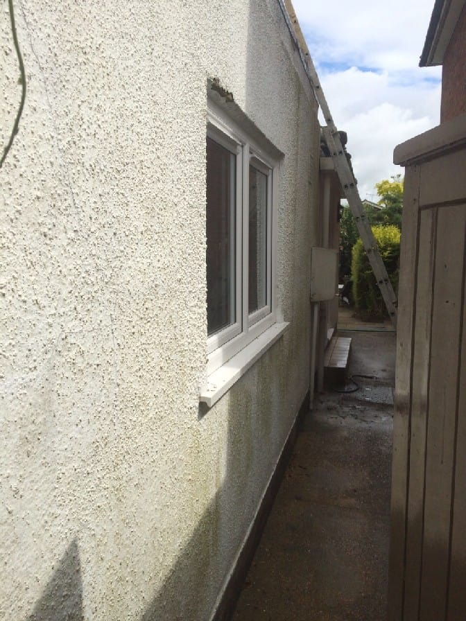 The side of the house was all green and mouldy and we had to powerwash all of this off before applying our weatherproof wall coatings.