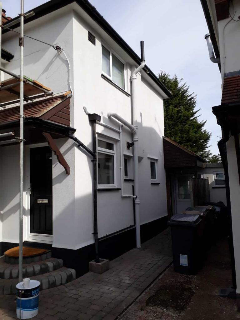 side of house with a new wall coating